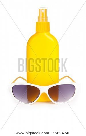 sunblock cream and sunglasses. isolated on a white background with a smooth reflection