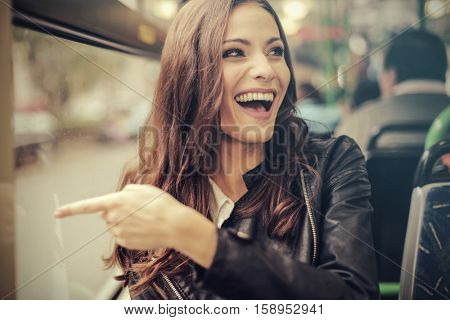 Girl seeing something funny during her bus ride