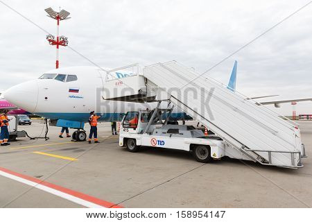 VNUKOVO, MOSCOW REGION, RUSSIA - 28 April 2016: Airplanes at Vnukovo international airport. Pobeda Airlines Boeing 737 ground service prepares the plane for the flight