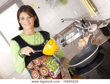 modern woman preparing some healthy food at her kitchen (selective focus with shallow DOF)