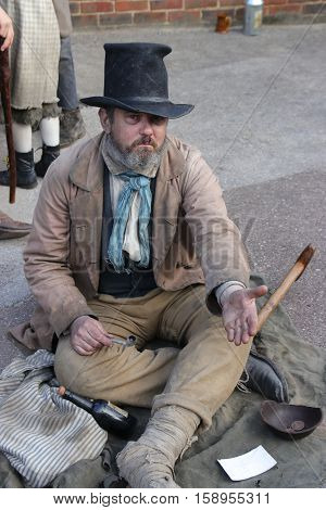 26TH NOVEMBER 2016, PORTSMOUTH DOCKYARD, ENGLAND:An unknown actor playing the part of a victorian gentleman at the yearly Christmas victorian festival in portsmouth dockyard,26th november 2016