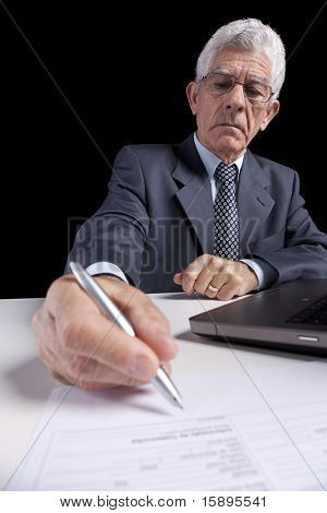 Senior businessman working with his laptop at his office