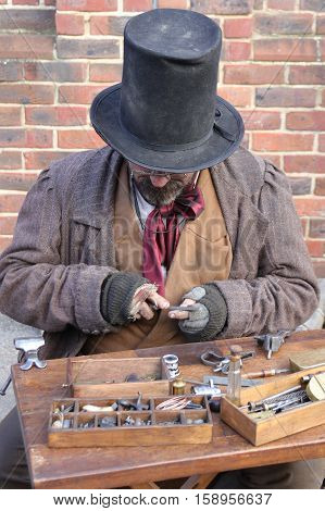 26TH NOVEMBER 2016, PORTSMOUTH DOCKYARD, ENGLAND:An unknown actor playing the part of a victorian gentleman at the yearly Christmas victorian festival in portsmouth dockyard,england,26th november 2016