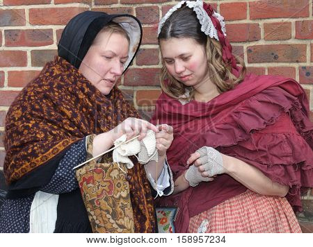 26TH NOVEMBER 2016, PORTSMOUTH DOCKYARD, ENGLAND:Two unknown actors playing the part of  victorian women at the yearly Christmas victorian festival in portsmouth dockyard,england,26th november 2016