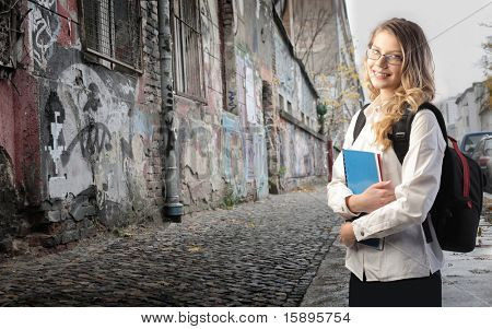 Beautiful student on a city street