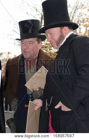 26TH NOVEMBER 2016, PORTSMOUTH DOCKYARD, ENGLAND:Two unknown actors playing the part of  victorian gentlemen at the yearly Christmas victorian festival in portsmouth dockyard,england,26th november 2016