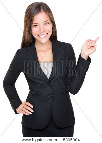 Businesswoman in suit pointing smiling. Isolated on white background. Asian Caucasian female model.