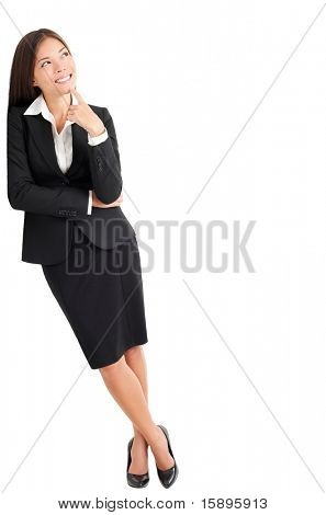 Businesswoman thinking leaning on wall looking up at copy space. Young mixed race Caucasian Asian professional woman isolated on white background