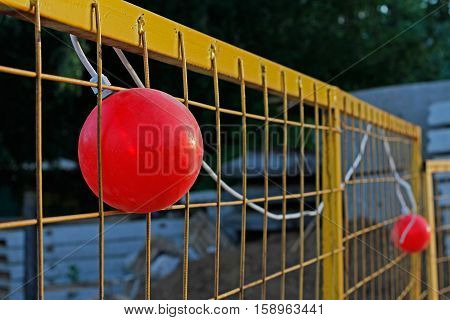 Red warning lights on the yellow fence