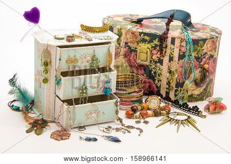Girl's and wife's jewelry box with drawers - feminine necklace, earrings, bendants, bracelets, rings, kitsch, watch - isolated on white - ideas for present
