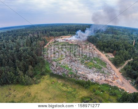 The view from the height of smoke fire on garbage dump