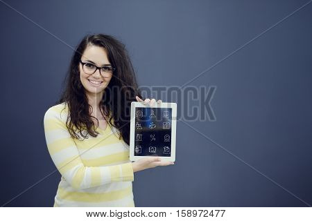 Young amazed woman on blue gray background with biology icons. Confusion.