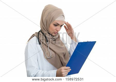 portrait of worried muslim female Medical doctor holding paperclip isolated.