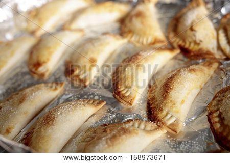 Pumpkin Pies Made By Hand.