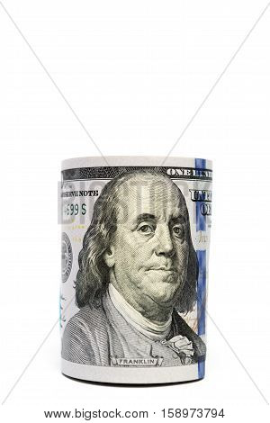 Benjamin Franklin detail on hundred-dollar bill stash isolated with copyspace