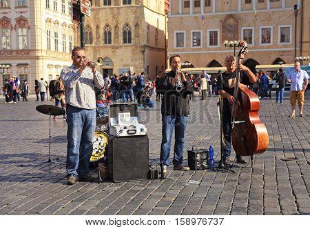 PRAGUE, CZECH REPUBLIC - OCTOBER 4, 2015: street musicians play jazz on Old Town Square, Prague, Czech Republic