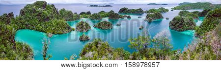 Painemo Island, Blue Lagoon, Raja Ampat, West Papua Indonesia, banner.