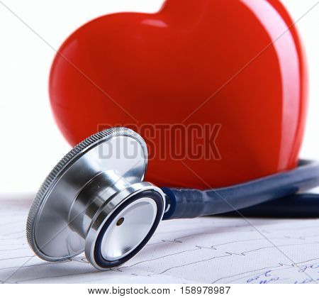 Red heart and a stethoscope on cardiagram.