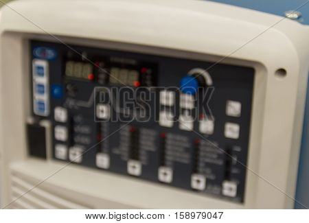 electronic control panel of welding machine in Factory. blur