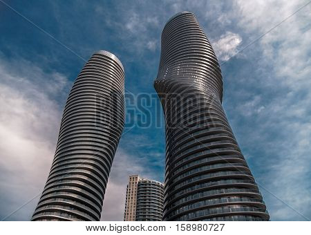 Toronto, Mississauga, Ontario, Canada, Apr. 28, 2013, gorgeous amazing beautiful majestic view of Mississauga city condo buildings against dramatic dark blue sky background