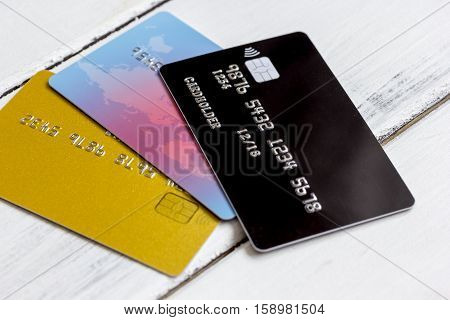Credit cards on wooden background - online shopping close up