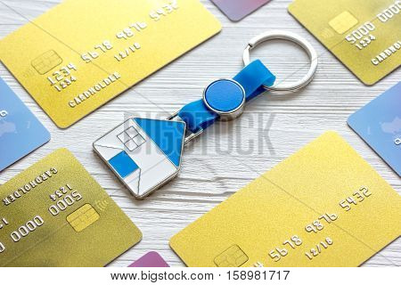 credit cards, key ring - concept mortgage on wooden background.