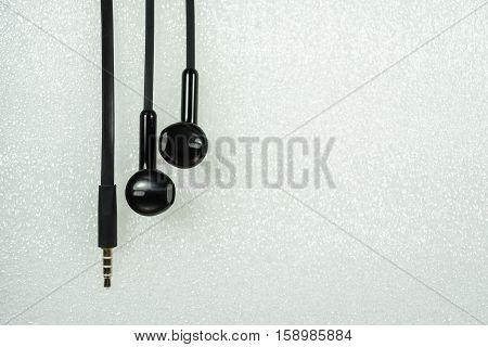 Black Earphone or earphones on white background the Black earphones for using digital music or smart phone