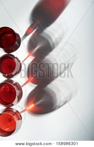 colourful shadows from wine glasses with stems isolated on white view from top