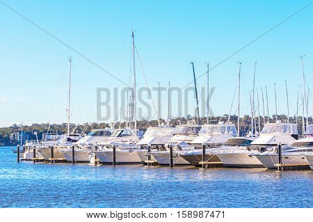 Boats lined up at their moorings in the Swan River in Perth, Western Australia.