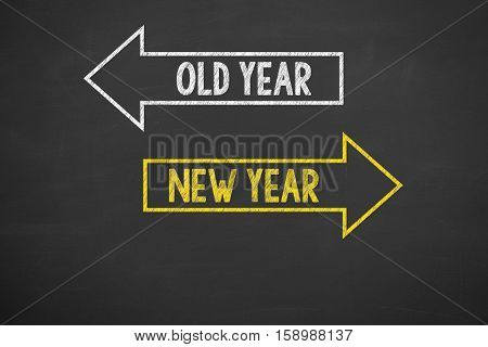 Human Hand Writing Old Year New Year on Chalkboard Background