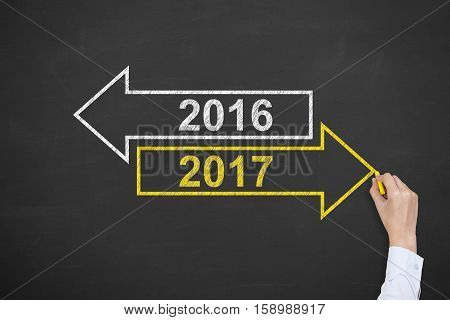 Old Year or New Year 2017 on Chalkboard Background