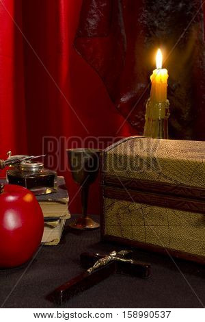 Vintage still life on a table covered with a black cloth
