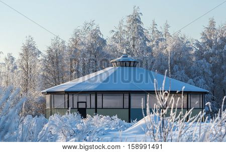 Horse stable. Covered round pen. Wintertime horizontal outdoors image.