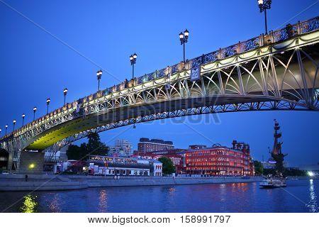 Beautiful Patriarchal Bridge and view of the Bersenevskaya promenade in the evening