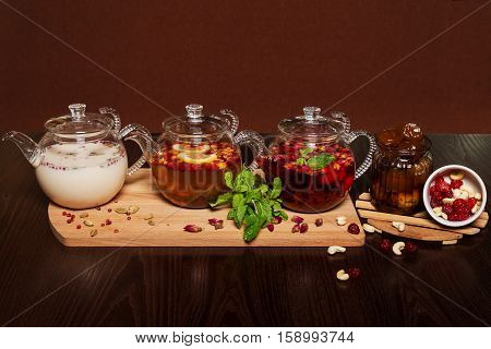 three teapots with different colors fruit tastes of tea