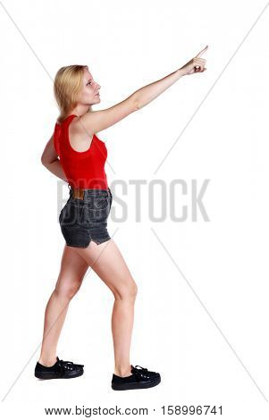 Back view of  pointing woman. beautiful girl. Rear view people collection.  backside view of person.  Isolated over white background. Long-haired blonde in shorts showing thumb up.