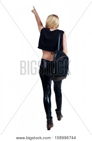 Back view of  pointing woman. beautiful girl. Rear view people collection.  backside view of person.  Isolated over white background. Long-haired blonde in leather pants is pointing upwards.