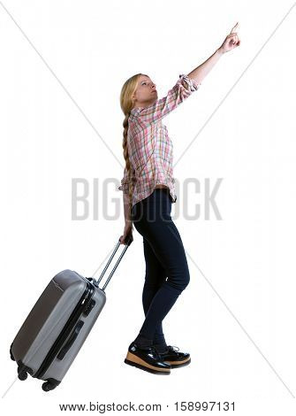 Back view of  pointing woman with suitcase looking up. Standing young girl.  backside view of person. Isolated over white background. Long-haired girl in the suitcase rolls over and shows his hand up.