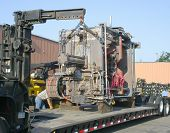 image of oversize load  - Loading a machine on a trailer to ship - JPG