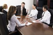 picture of business meetings  - Team of successful business people are sitting at the table and discussing - JPG