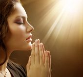 stock photo of pray  - Praying Woman - JPG