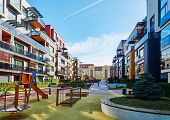 Modern Residential Buildings And Children Playground poster