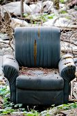 foto of junk-yard  - Chair in the middle of junk yard - JPG