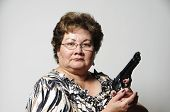 picture of fat woman  - a mature woman holding a handgun showing she is ready to defend herself - JPG