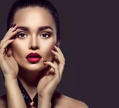 Beauty Brunette Woman with Perfect Makeup. Beautiful Professional Holiday Make-up. Red Lips and Nail poster
