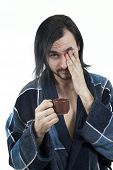 image of housecoat  - sleepy man in housecoat with little cup of coffee - JPG