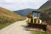 picture of jcb  - A mechanical digger parked in remote highland glen - JPG