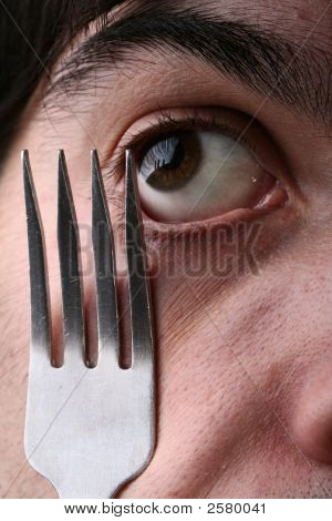 Man Eye And Fork
