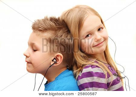 Boy and girl listening music, isolated on white background.