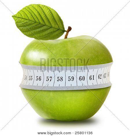 Grüner Apfel mit Messung, isoliert auf weiss